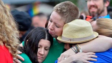Participants hug at the foot of the Hillcrest Pride Flag during the rally. Photo by Chris Stone