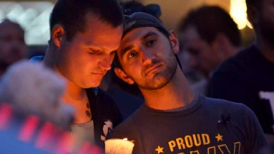 A couple listens to the names of victims in Orlando, Florida. Photo by Chris Stone