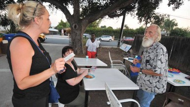 """Liz Lavertu, who expects to be elected to the Spring Valley Community Planning Board, handed out cards for Patrick Malloy, """"Berniecrat"""" candidate for Congress. Photo by Ken Stone"""