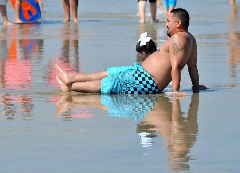 Man on beach beating the heat