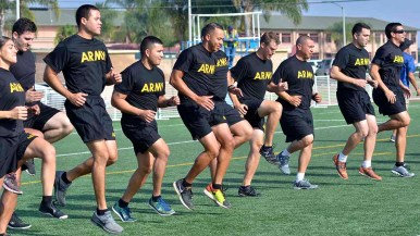 An Army team warms up at NFL Boot Camp at Marine Corps Air Station Miramar. Photo by Chris Stone