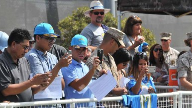 Family members and others watched drills and Chargers practice at Marine Corps Air Station Miramar. Photo by Chris Stone