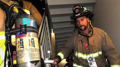 Rancho Santa Fe firefighter Kyle Carranza begins his climb. Photo by Chris Stone