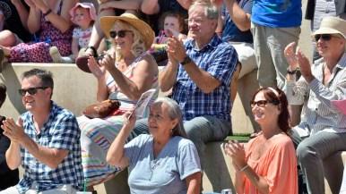 Audience members applaud the opera performance. Photo by Chris Stone