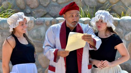 The two stepsisters and their father, Don Magnifico, get news of the prince's ball. Photo by Chris Stone