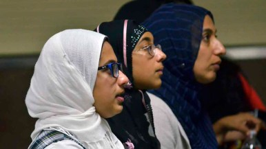 Young Muslim women listen to the presidential candidates at the Islamic Center of San Diego. Photo by Chris Stone