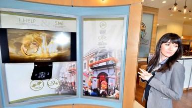 Scientology spokeswoman Erin Banks showed off interactive displays on first-floor Information Center. Photo by Ken Stone