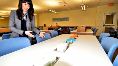 Scientology spokeswoman Erin Banks showed off desks with places for modeling clay for auditor trainees. Photo by Ken Stone