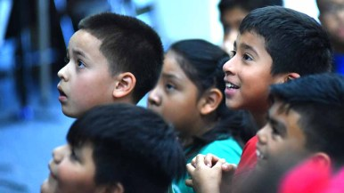Children eagerly wait and hope their names are called. Photo by Chris Stone