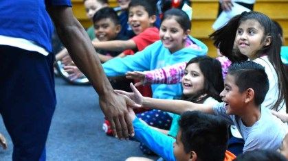 Chargers player Tyrell Williams is greeted by second- and third-graders at Baker Elementary School. Photo by Chris Stone