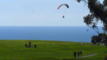 Hang gliders floated above the sea by the Torrey Pines Golf Course during the Zurich Pro-Am. Photo by Chris Stone