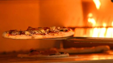Pizza warms in oven at new UCSD restaurant, which is open to the public. Photo by Chris Stone