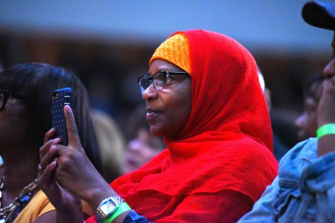 A Muslim woman in the front row records Angela Davis' speech at Southwestern College. Photo by Chris Stone