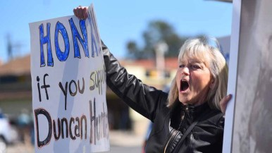 Laura Clary of Escondido shows sign of support for thhe five-term Republican congressman. Photo by Chris Stone