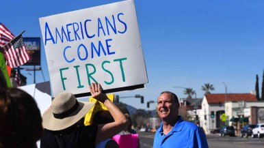 Immigration issues were foremost for many waiting for start of Town Hall in Ramona. Photo by Chris Stone