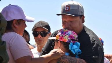 Family members of Maria de Lourdes Mendoza Guizar hug daughter, Emily. Photo by Chris Stone