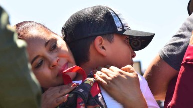 Isaiah Anthony Martinez meets a relative on the Mexican side of the border. Photo by Chris Stoner