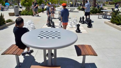 A game area for chess and checkers play and table tennis is in the plaza at Civita Park in Mission Valley. Photo by Chris Stone