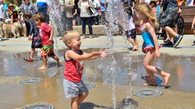 Children play in the 48-jet splash pad at the new Civita Park in Mission Valley. Photo by Chris Stone