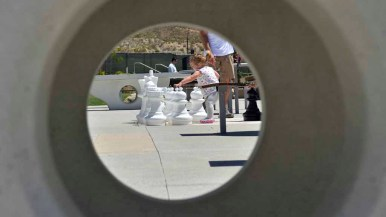 A toddler checks out the chess pieces at Civita Park in Mission Valley. Photo by Chris Stone