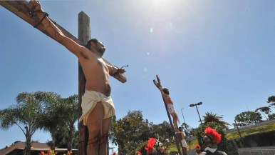 Thieves are hung on each side of Jesus in the re-enactment. Photo by Chris Stone