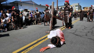 Actors re-enact the Stations of the Cross on the streets of Barrio Logan. Photo by Chris Stone