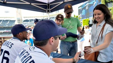 Fans ask for autographs of pitcher Jose Torres and outfielder Hunter Renfroe. Photo by Chris Stone