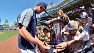 San Diego Padres star first baseman Wil Myers signs autographs for enthusiastic fans. Photo by Chris Stone