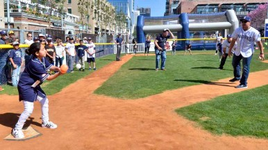 Padres outfielder Hunter Renfroe pitches in a wiffle ball game at FanFest. Photo by Chris Stone