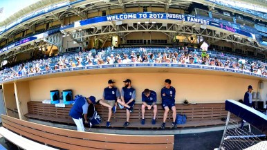 Players and coaches relax in the dugout during batting practice at Padres FanFest. Photo by Chris Stone