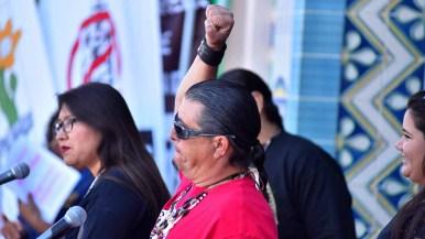 Bobby Wallace of the Barona Band of Mission Indians of the Kumeyaay Nation gestures at rally before People's Climate March San Diego. Photo by Ken Stone