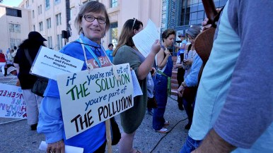 Roni Breite of San Carlos, a former newspaper headline writer, created her own sign for People's Climate March San Diego. Photo by Ken Stone