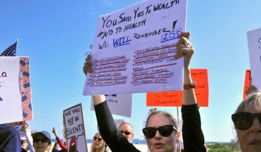 Protestors gathered outside the Hotel del Coronado, where the Republican National Committee Spring Meeting is being held. Photo by Chris Stone