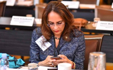 Harmeet Dhillon of San Francisco checks her phone before RNC Rules Committee meeting at Hotel del Coronado. Photo by Ken Stone