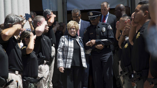 Bonnie Dumanis is saluted as she leaves her office for the last time. Courtesy of the District Attorney's Office
