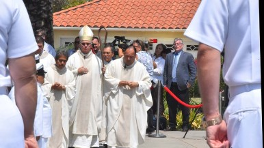 Most Rev. John Dolan (left) and Rev. Efrain Bautista led the procession after the funeral. Photo by Chris Stone
