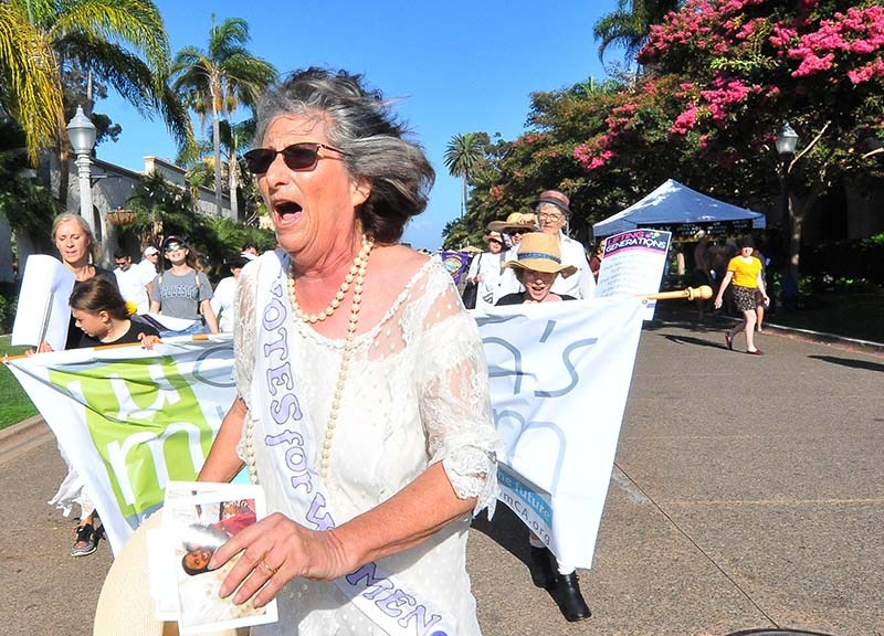 Judy Forman leads a suffragette march with about 80 people in Balboa Park.