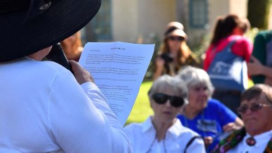 Jane Samuels of the National Organization of Women reads a passage about Alice Paul at the annual suffrage march in Balboa Park.