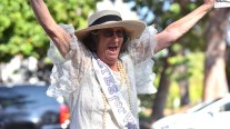 Judy Forman leads the cheer for woman's suffrage at a march in Balboa Park.