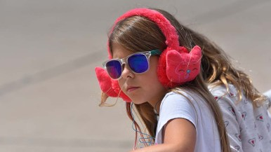 A young spectator sports ear protection at the Miramar Air Show.