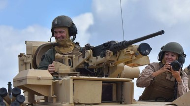 Tank personnel smile at the crowd.