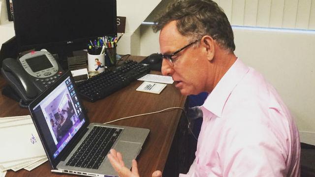 Rep. Scott Peters using Skype on a laptop