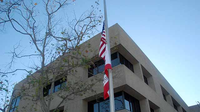 Flags flying at half-staff at San Diego County Sheriff's Department Headquarters in Kearny Mesa in memory of the Sutherland Springs shooting victims.