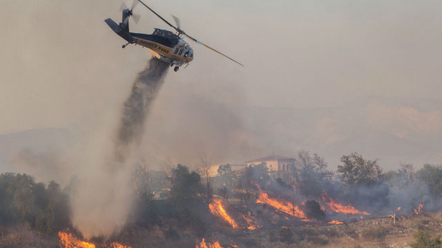 Helicopter drops water on Creek Fire