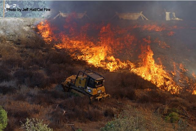 Bulldozer and flames