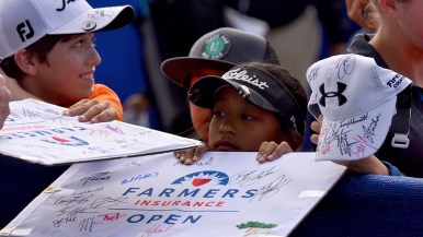 Children try to score autographs from Torrey Pines finishers.