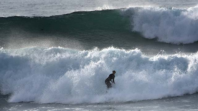 A few surfers braved the waves at Windansea Beach projected to be higher than 10 feet.