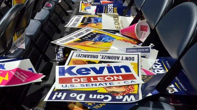 Campaign signs are abandoned on convention seats.