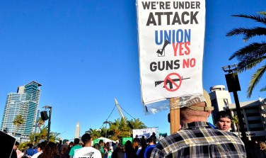 "Union members attend a ""Working People's Day of Action"" rally outside of the San Diego Convention Center."