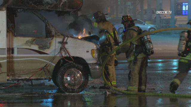 Oceanside firefighters and burning motor home